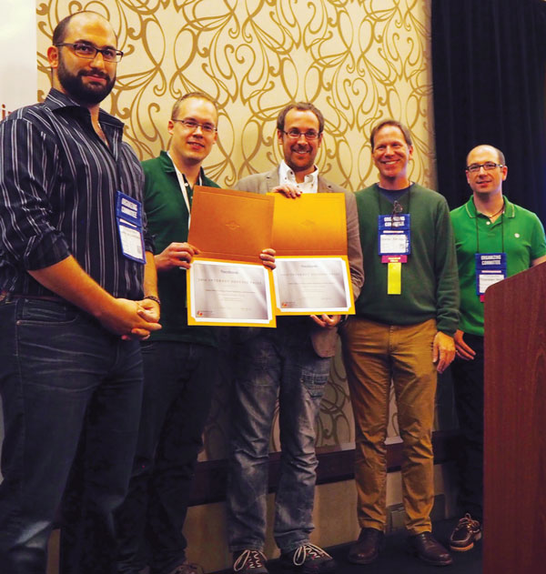 Some of the 2016 Internet Defense Prize winners: second from the left is Thomas Pöppelmann; Peter Schwabe is standing next to him (Alkim and Ducas not pictured). Source: USENIX.