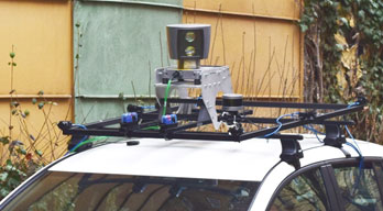 Figure 1: A host of image and range sensors are mounted onto the electric test car.