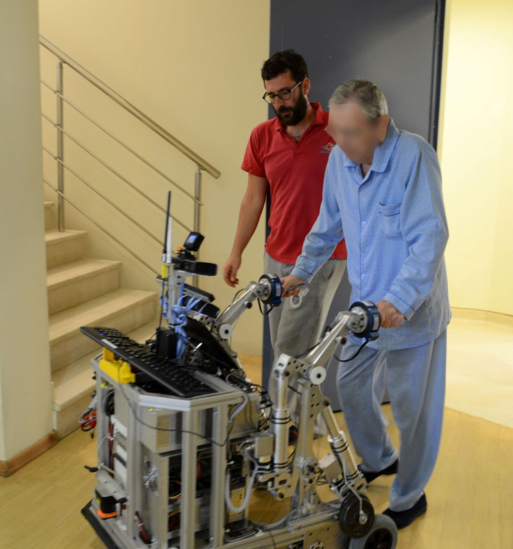 Figure 1: User navigating interaction during MOBOT rollator evaluation.