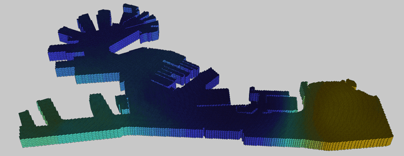 Figure 1: A geometric representation of the harbour in Genoa (Italy). It represents the water volume within the pier structures and the seabed. The 3D model is a structured grid of voxels of equal size and it is generated starting from bathymetric data and known boundaries of the piers. The different colours show an example distribution of an environmental variable associated to grid cells.