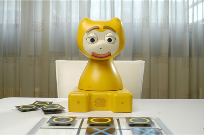 Figure 1: iCat, here as a game buddy for children.