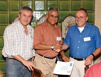 From left: Pedro Merino ERCIM FMICS Working Group coordinator and workshop co-organiser; Ganesh Gopalakrishnan winner of the FMICS best paper award; and Stefan Leue, University of Konstanz, workshop co-organiser.