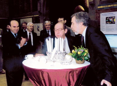 ERCIM celebrated its 10th anniversary in Amsterdam in November 1999. ERCIM president Gerard van Oortmerssen (center) and Stelios Orphanoudakis who succeeded him as president in 2004, are blowing the candles. Sadly, due to illness, Stelios' presidency was all too short.