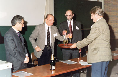 ERCIM Directors give a toast on Rutherford Appleton Laboratory (RAL) joining ERCIM as fourth ERCIM member in November 1990. From left: Alain Bensoussan (INRIA), Gerhard Seegmuller (GMD), Paul Williams (RAL), Cor Baayen (CWI).