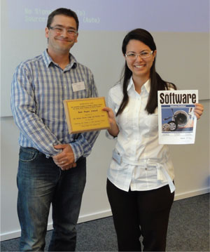 Anthony Cleve (left), ERCIM fellow and workshop co-organiser, and Lile Hattori, first author of the award-winning paper.