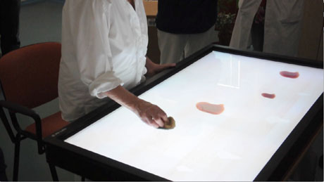 Training phase: an elderly patient using the interactive tabletop at Montedomini.