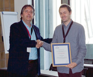 Georg Fuchsbauer (right) receives the ERCIM Security and Trust Management PhD thesis award from Javier Lopez.