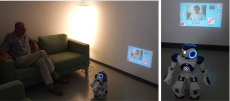Figure 2: NAO robot with a LED projector unit on its back during video communication between KSERA user (sitting on a couch) and a call centre operator.