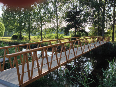 This footbridge (Nederwetten, The Netherlands) is made of more steel than strictly necessary to assure its quality. Software engineers must also consciously employ redundancy to ensure quality.